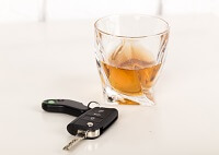 Alcohol and keys on a table - DWI
